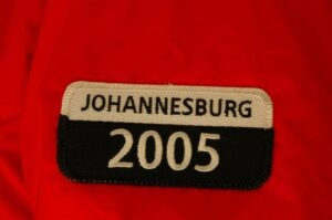 Close up of a red jacket with a Johannesburg 2005 patch
